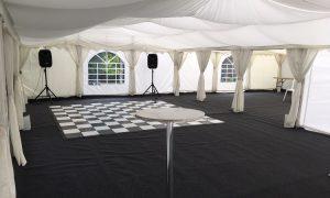 Dance floor in marquee with speakers