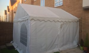 small marquee attached to house
